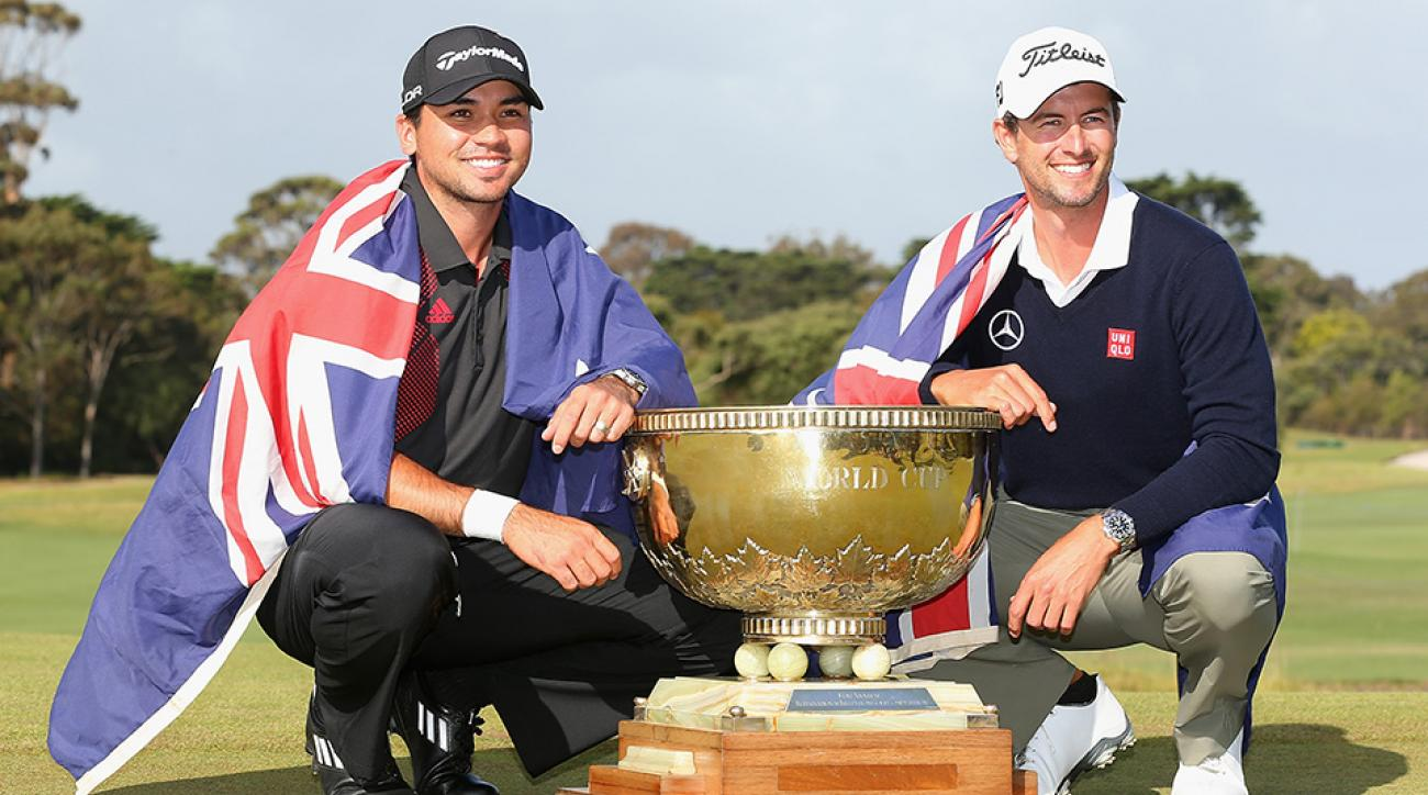 Jason Day and Adam Scott of Australia pose with the trophy after winning the team event of the 2013 World Cup of Golf at Royal Melbourne.