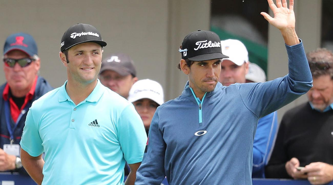 Rafa Cabrera Bello and Jon Rahm of Spain gesture to the crowd during day one of the World Cup of Golf at Kingston Heath Golf Club.