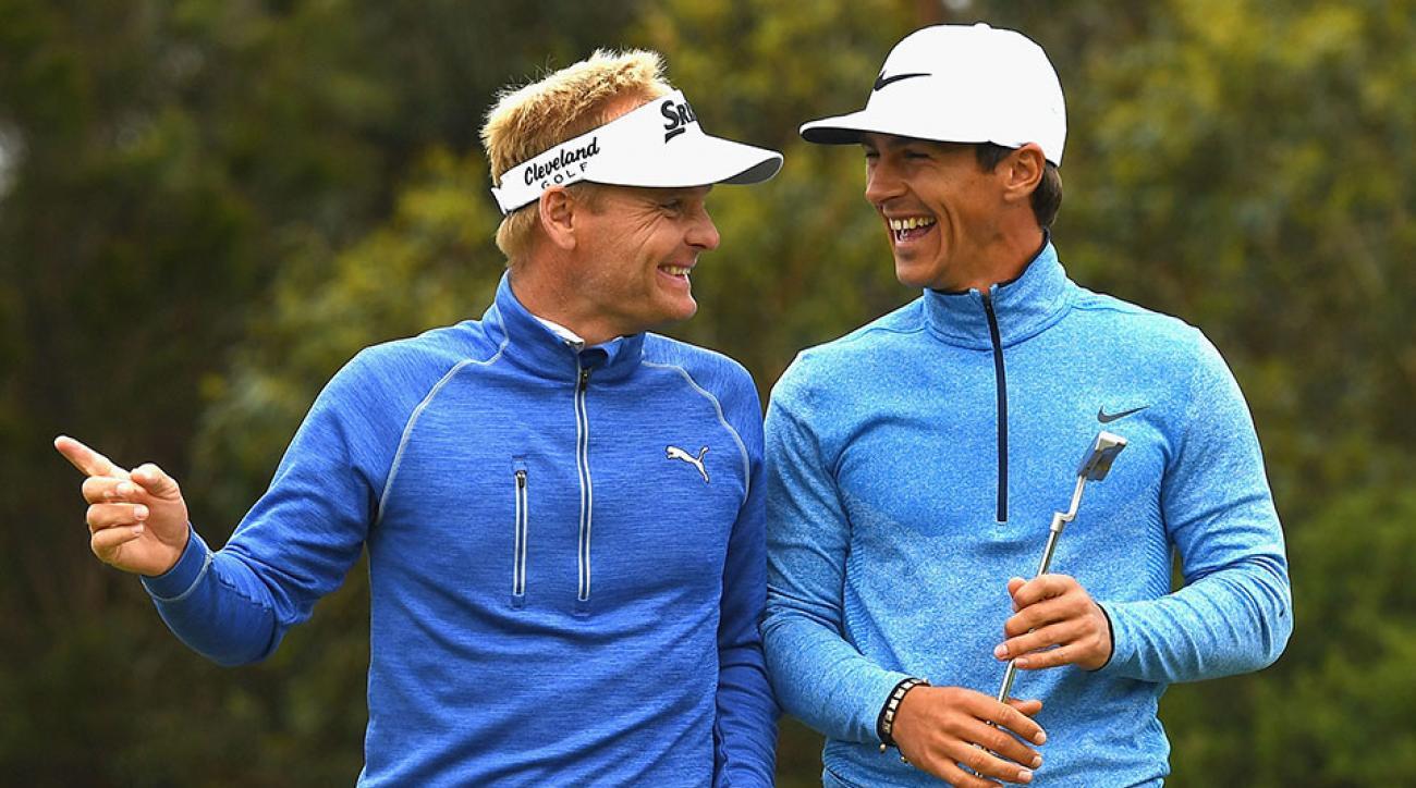 Soren Kjeldsen and Thorbjorn Olesen of Denmark celebrate a birdie during day two of the 2016 World Cup of Golf at Kingston Heath Golf Club.