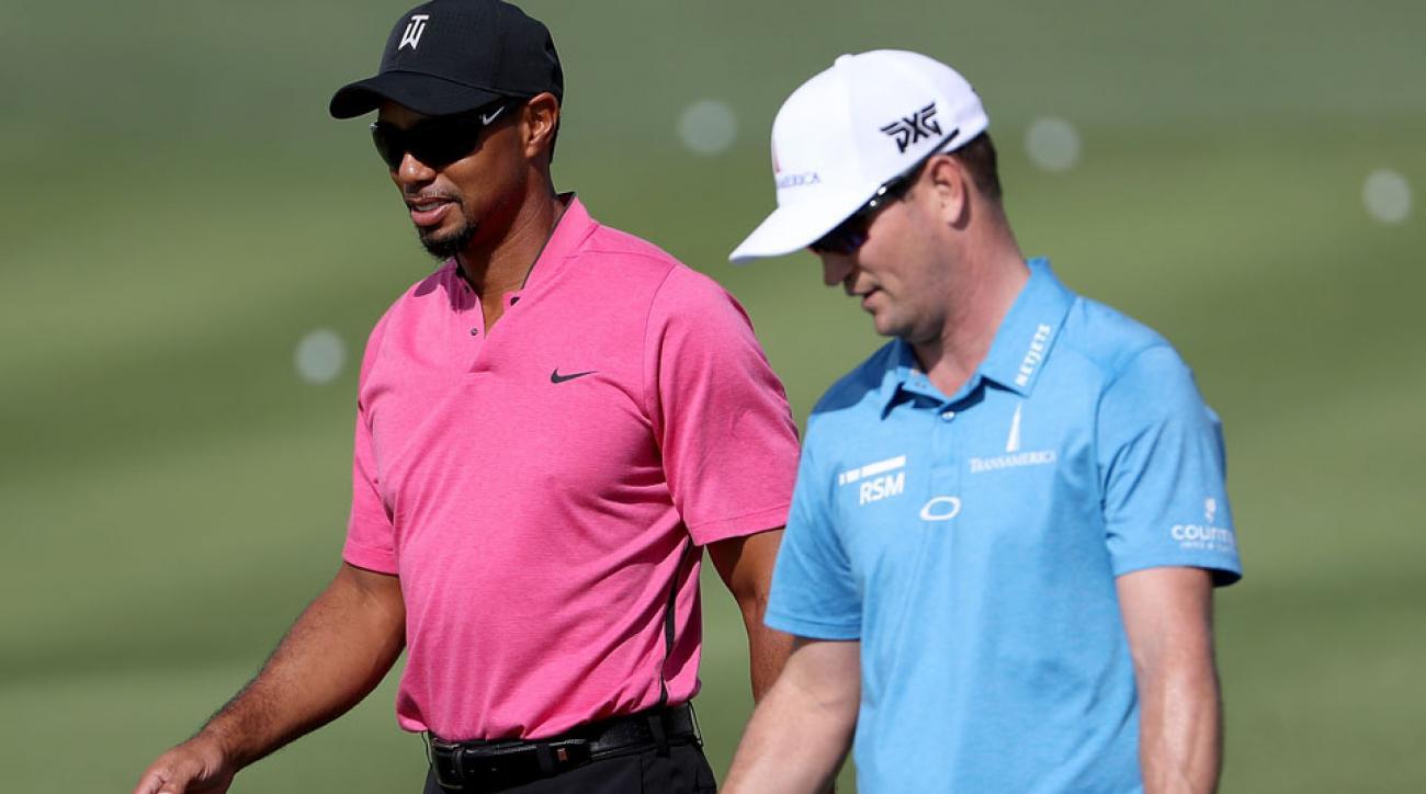Tiger Woods walks with Zach Johnson at the Hero World Challenge.