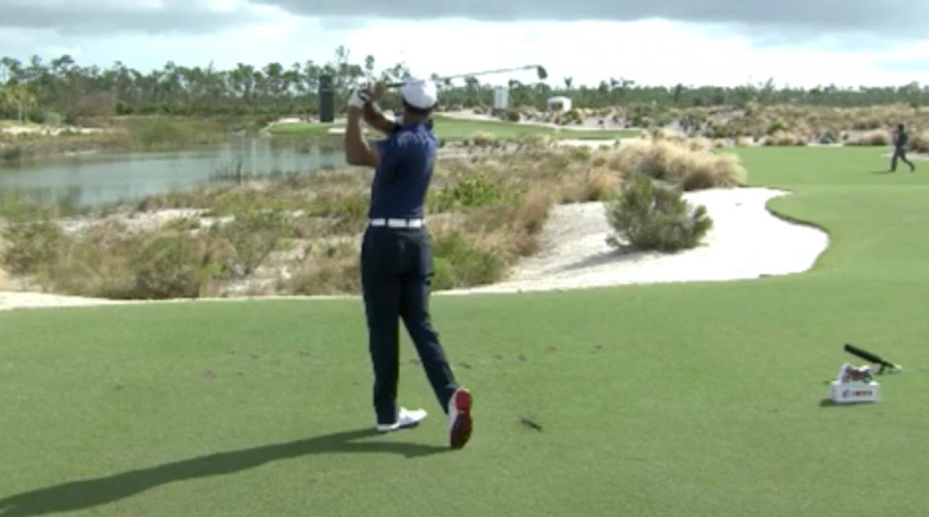 Tiger Woods stuck it on the par-3 12th.