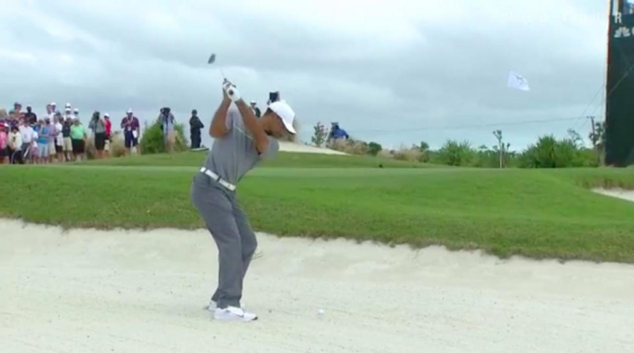 Tiger Woods would jar this bunker shot for birdie at the par-3 5th hole on Saturday.