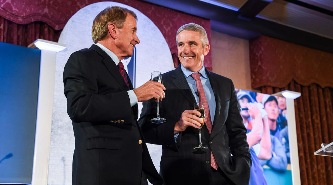 Outgoing PGA TOUR Commissioner Tim Finchem, left, is toasted by incoming Commissioner Jay Monahan in November.