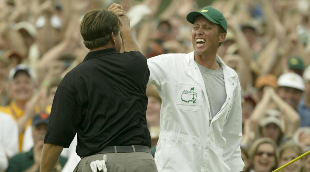"Phil Mickelson and caddie Jim ""Bones"" Mackay celebrate their 2004 Masters win."