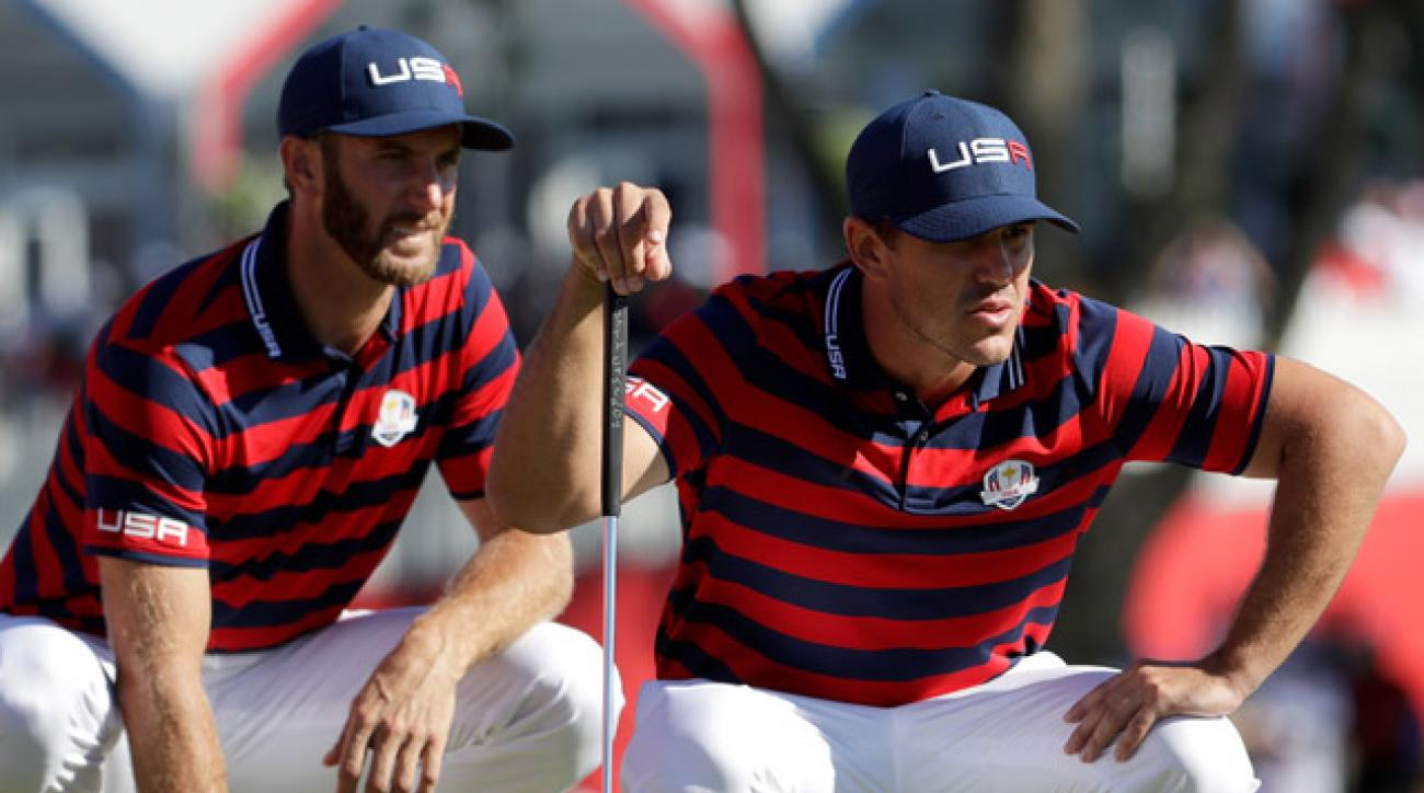 Dustin Johnson and Brooks Koepka of the United States line up a putt on the ninth green during afternoon fourball matches of the 2016 Ryder Cup.