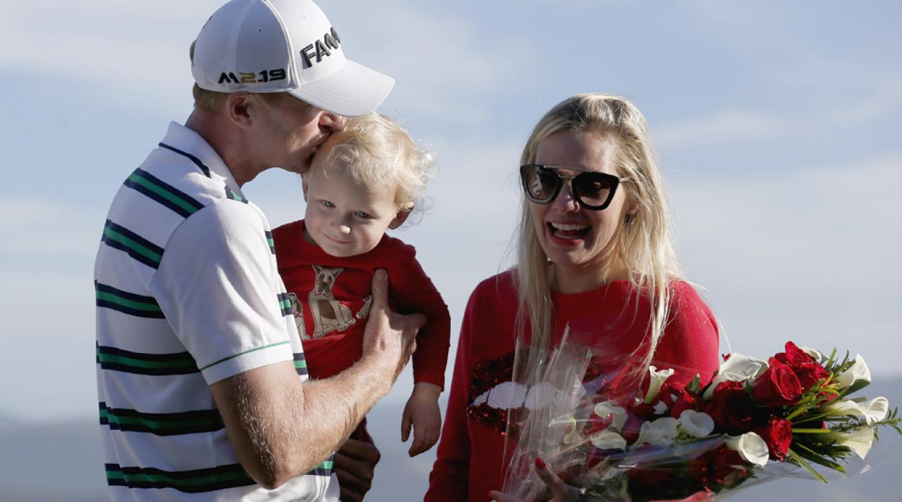Vaughn Taylor celebrates with wife Leot and son Locklyn after winning the AT&T Pebble Beach National Pro-Am.