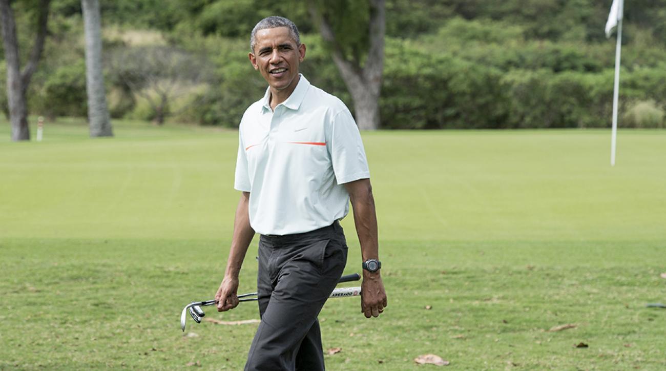 US President Barack Obama plays golf with Malaysian Prime Minister Najib Razzak at Marine Corps Base Hawaii on December 24, 2014.
