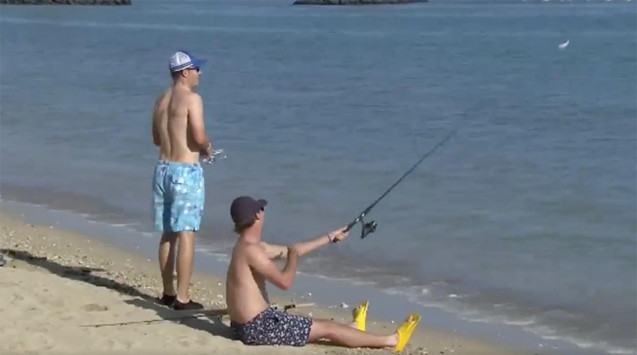 Jordan Spieth and Smylie Kaufman fishing after their rounds at the Sony Open.