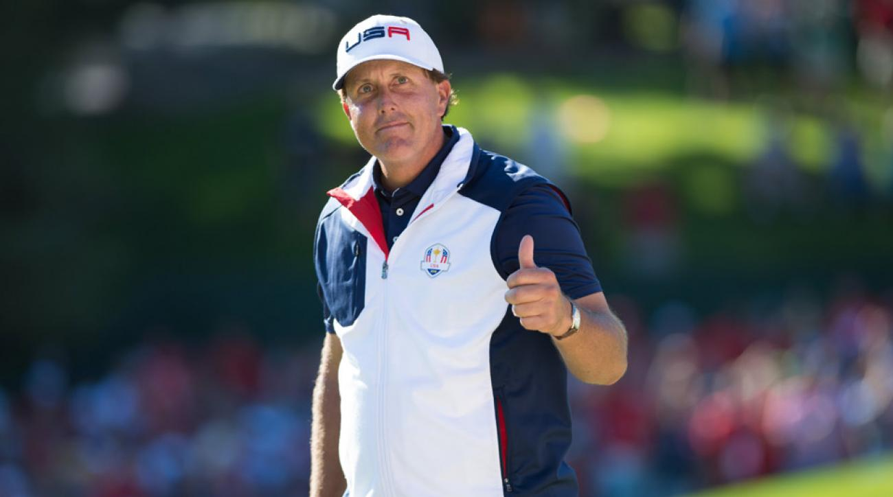 Phil Mickelson of the United States acknowledges the gallery on the 15th hole during the singles matches for the 41st Ryder Cup at Hazeltine National Golf Course.