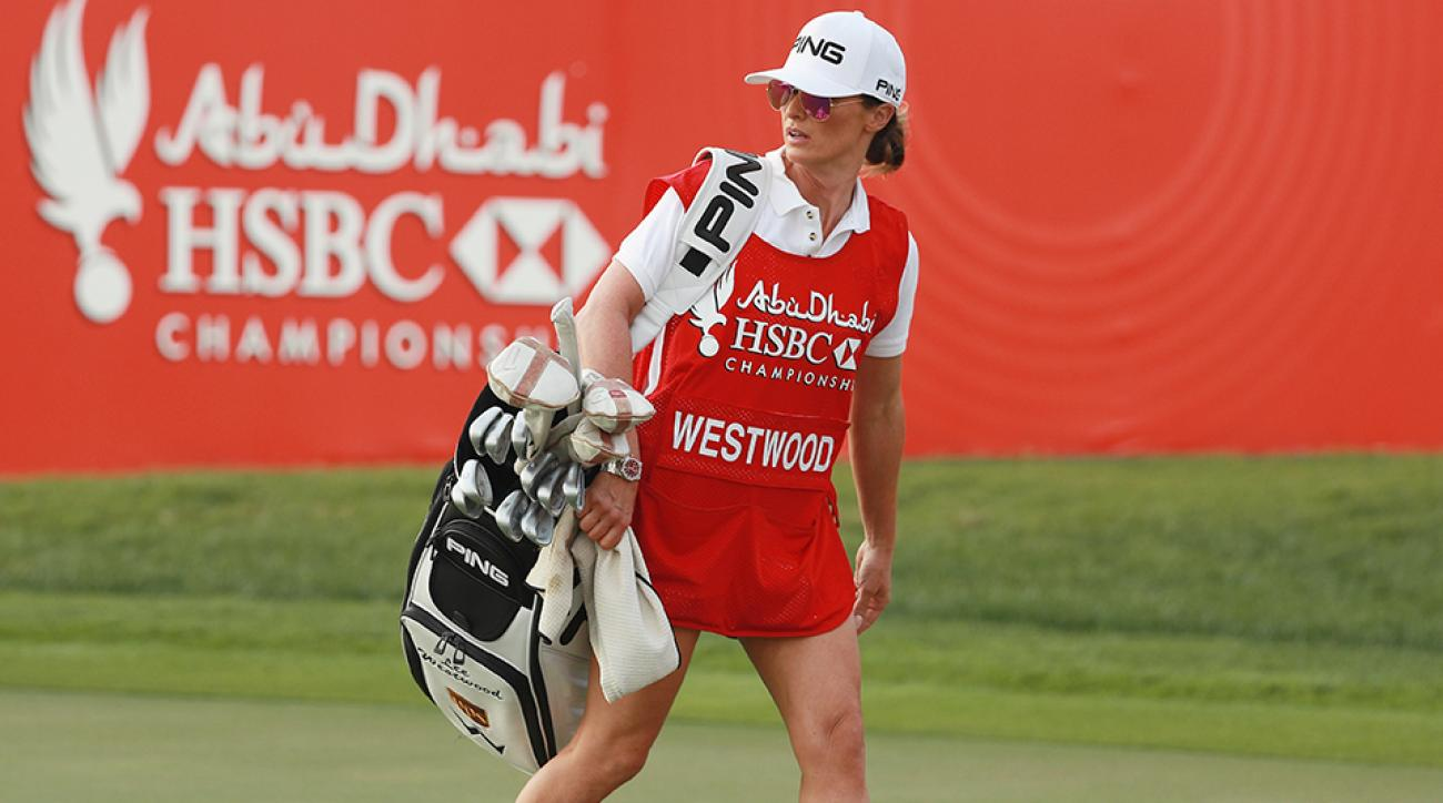 Helen storey the girlfriend and caddie of lee westwood carries his bag during the