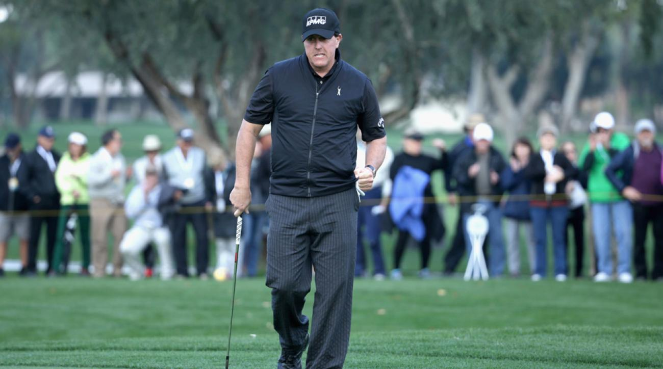 Phil Mickelson reacts to his par save on the 16th hole during the first round of the CareerBuilder Challenge.