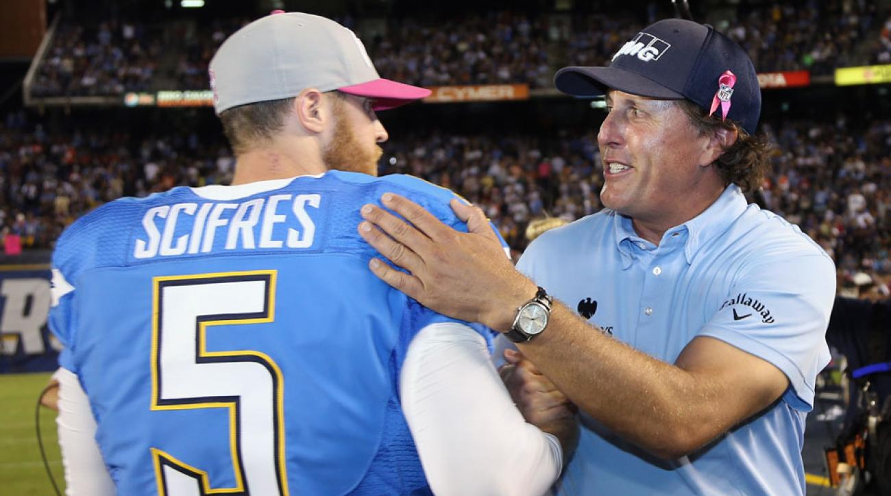 Phil Mickelson greets longtime Chargers punter Mike Scifres at a game in 2012.