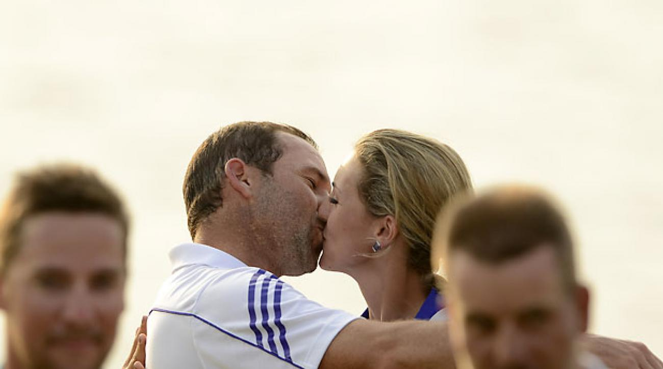 BANGKOK, THAILAND - DECEMBER 15: Sergio Garcia of Spain kisses his girlfriend and caddy Katharina Boehm of Germany on the 18th green after his win during day four of the Thailand Golf Championship at Amata Springs Country Club on December 15, 2013 in Bangkok, Thailand.  (Photo by Paul Lakatos/Asian Tour/Asian Tour via Getty Images)
