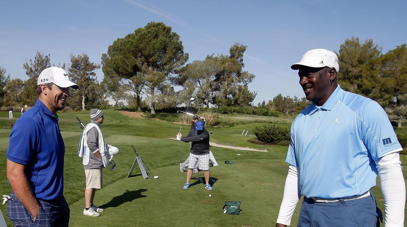 Green Bay Packers quarterback Aaron Rodgers and Michael Jordan warm up on the driving range Thursday at Shadow Creek in North Las Vegas.