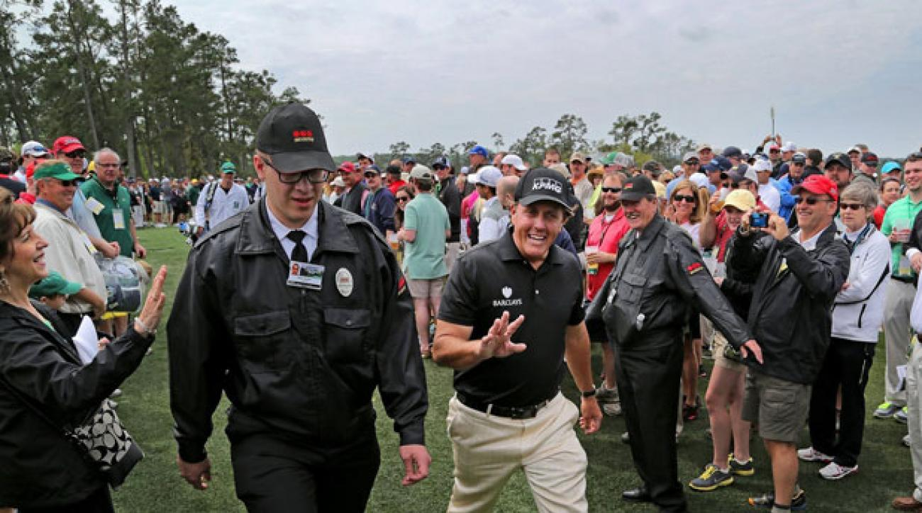 Phil Mickelson makes his way to the clubhouse after finishing a practice round Tuesday at Augusta National.