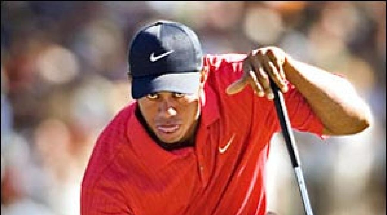 """Woods wielded a hot putter as he pulled away during the last round. """"I had one of those magical days on the greens,"""" he said."""