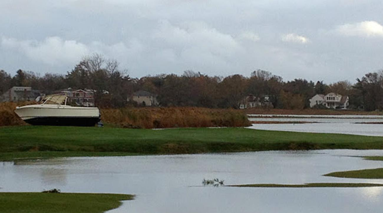 Hurricane Sandy left a boat in the fairway at No. 15 at Rockaway Hunting Club in Lawrence, N.Y.