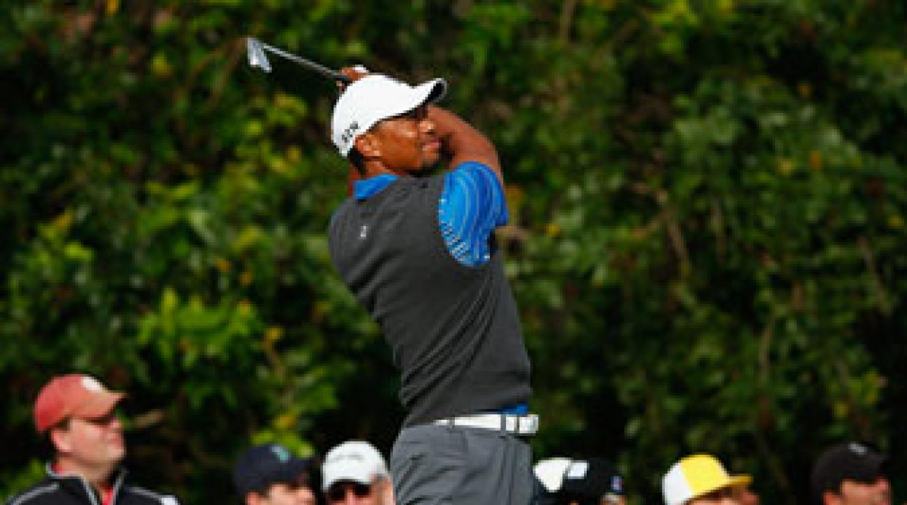 Tiger Woods plays a shot on the 15th hole during the first round of The Honda Classic at PGA National.