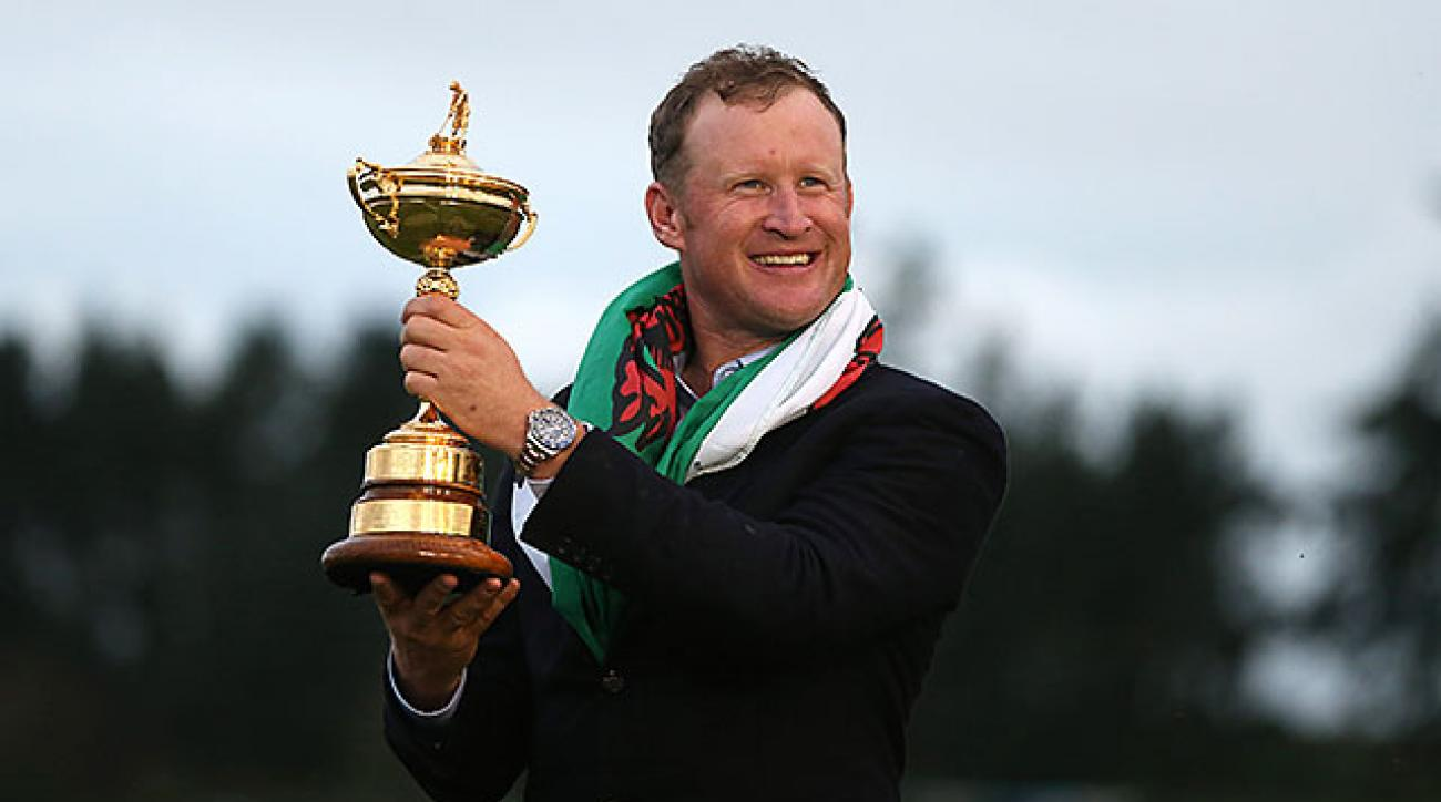 Jamie Donaldson poses with the Ryder Cup trophy after he hit the winning shot for Team Europe.