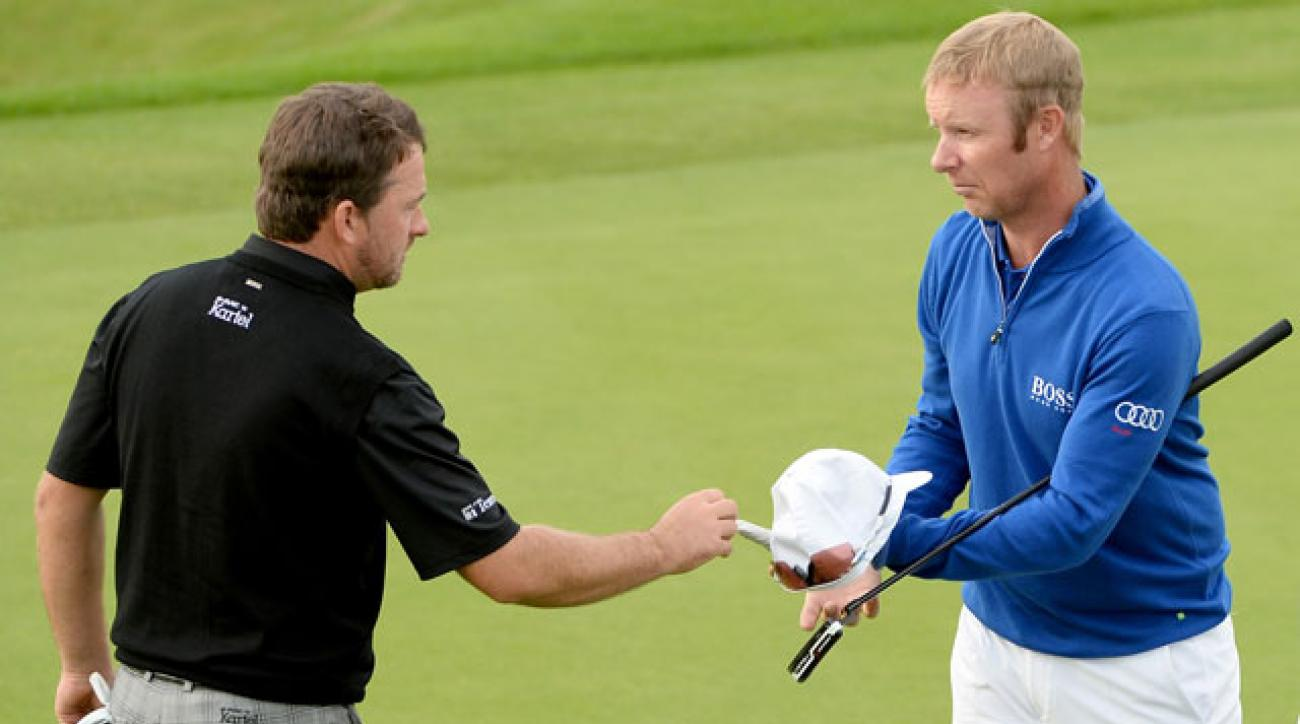 Mikko Ilonen of Finland defeats Graeme McDowell of Northern Ireland 2&1 during the first round matches of the Volvo World Match Play Championship at The London Club.