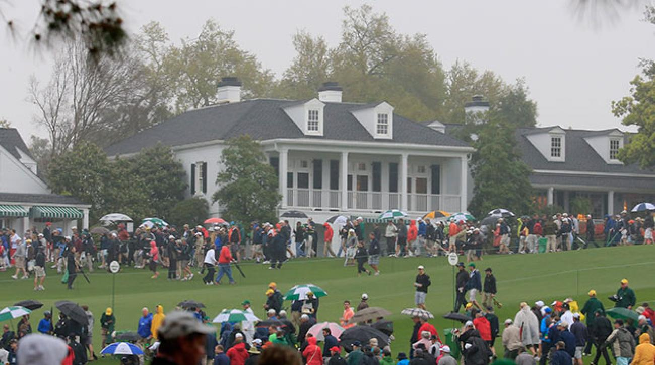Patrons are evacuated from the course after play was suspended due to weather on Monday.