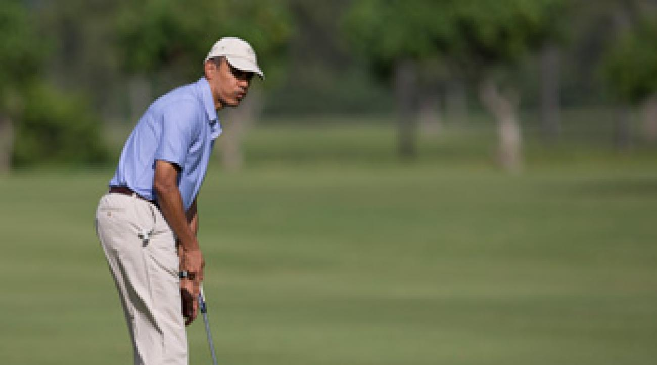President Barack Obama playing golf in Hawaii in January 2014.