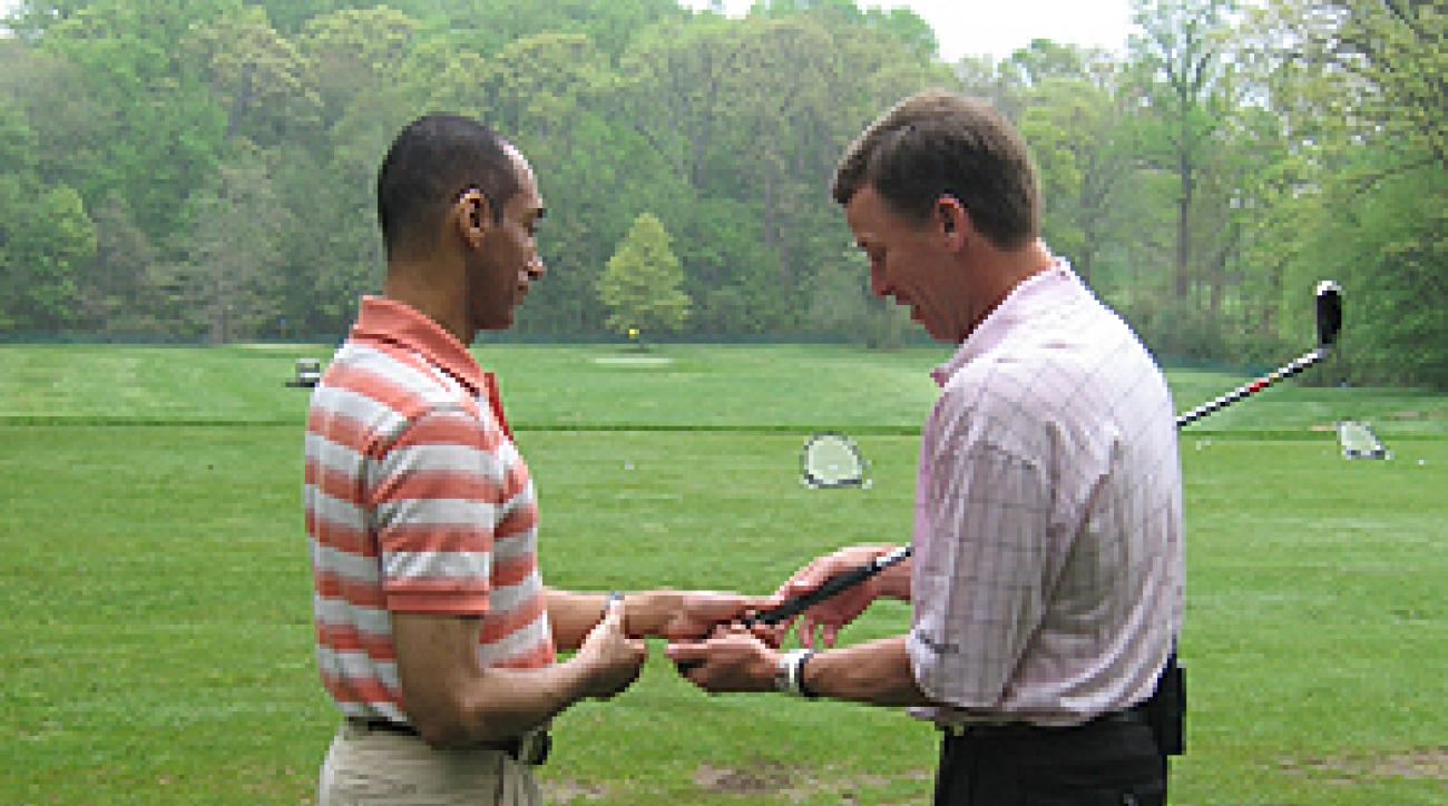 Michael Breed, right, shows Suleiman Rifai how to hold the club.