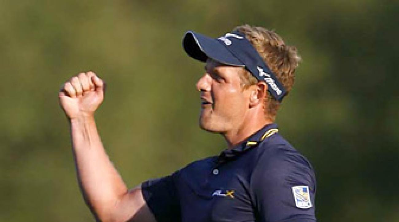 Luke Donald won the Transitions Championship to end Rory McIlroy's two-week reign at No. 1.