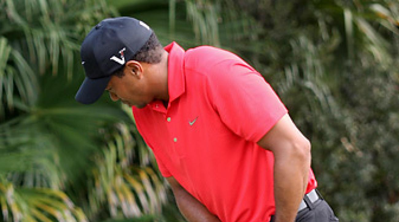 Tiger Woods withdrew from Doral with what he later said was an injury to his left Achilles.