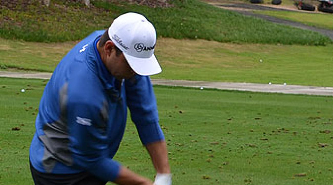 Moving at 130 mph, Woodland's driver blurs as it races toward the ball.