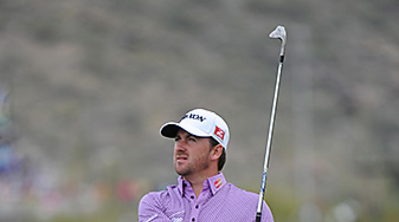 Graeme McDowell came back from four holes down to defeat Gary Woodland.