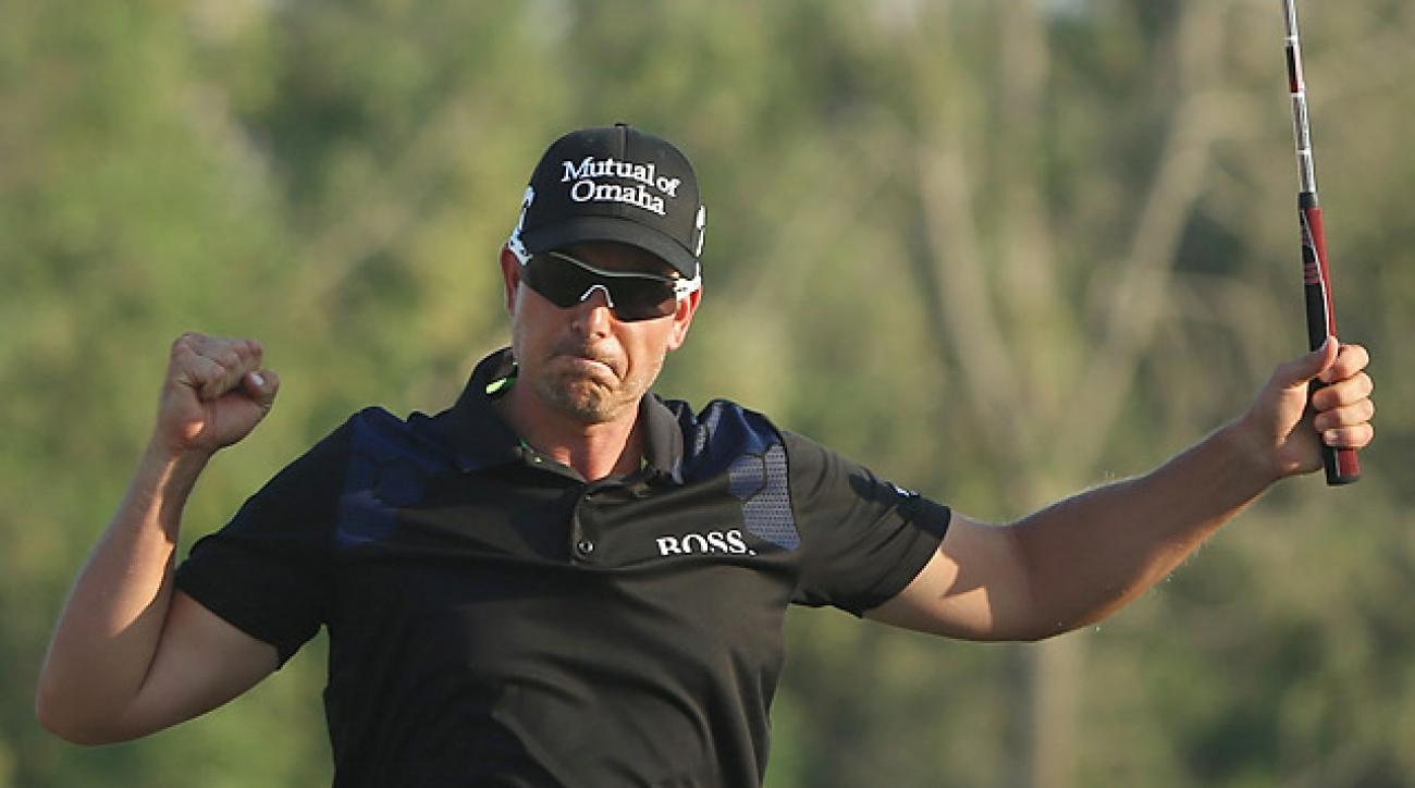 Henrik Stenson of Sweden celebrates after winning the DP World Tour Championship.
