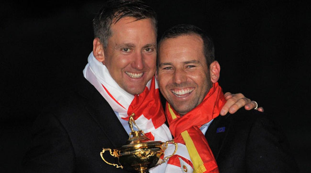 Ian Poulter and Sergio Garcia celebrate Team Europe's victory at the 2014 Ryder Cup at Gleneagles.