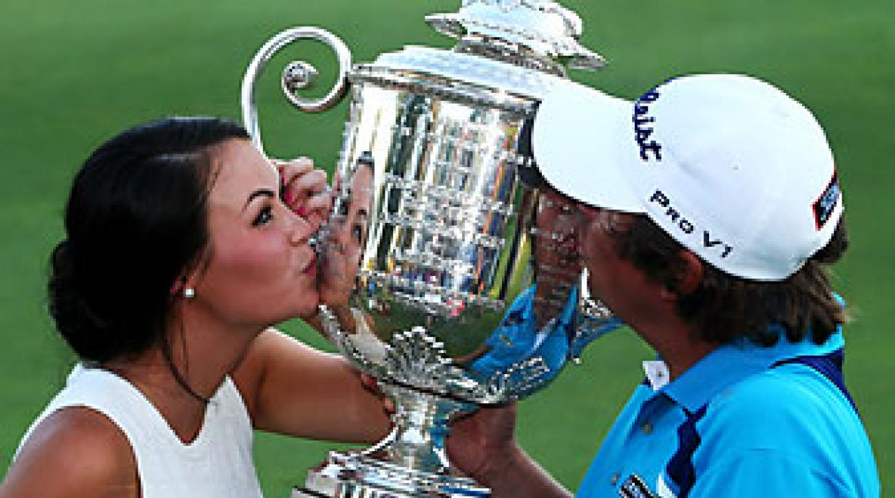 Jason Dufner and his wife Amanda get acquainted with the Wanamaker Trophy after Jason won the 2013 PGA Championship at Oak Hill.