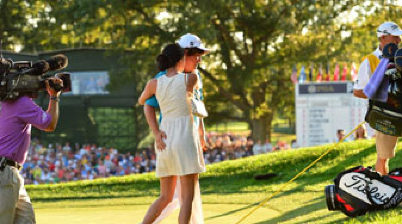 Jason Dufner's friendly pat of wife Amanda after winning the 2013 PGA Championship.