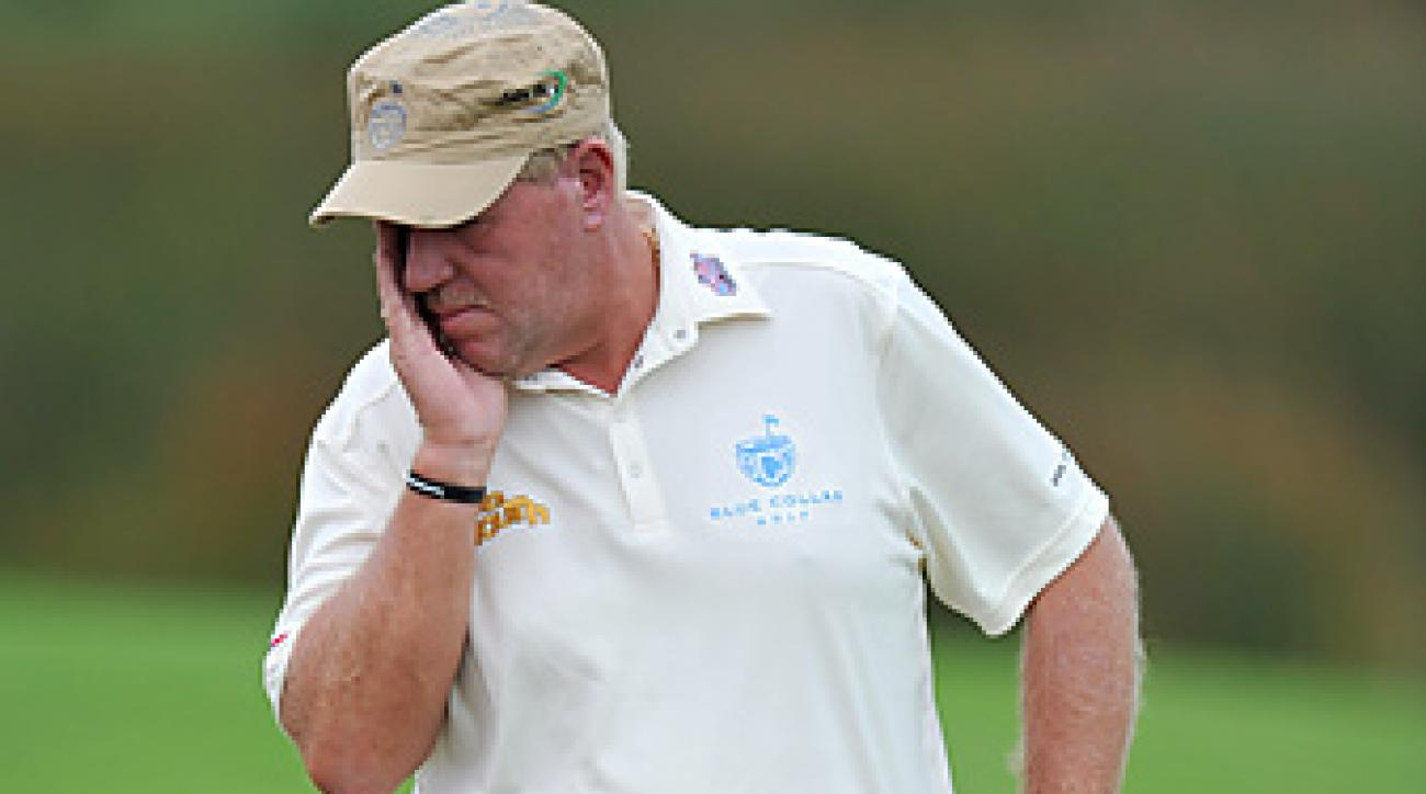 John Daly walked off the course after hitting seven balls into the water in the first round at the Australian Open.