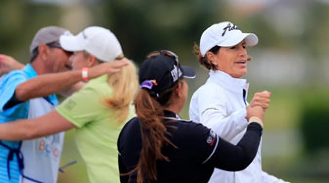 Juli Inkster (right) and Lizette Salas fist bump during the Pure Silk Bahamas LPGA Classic in January.