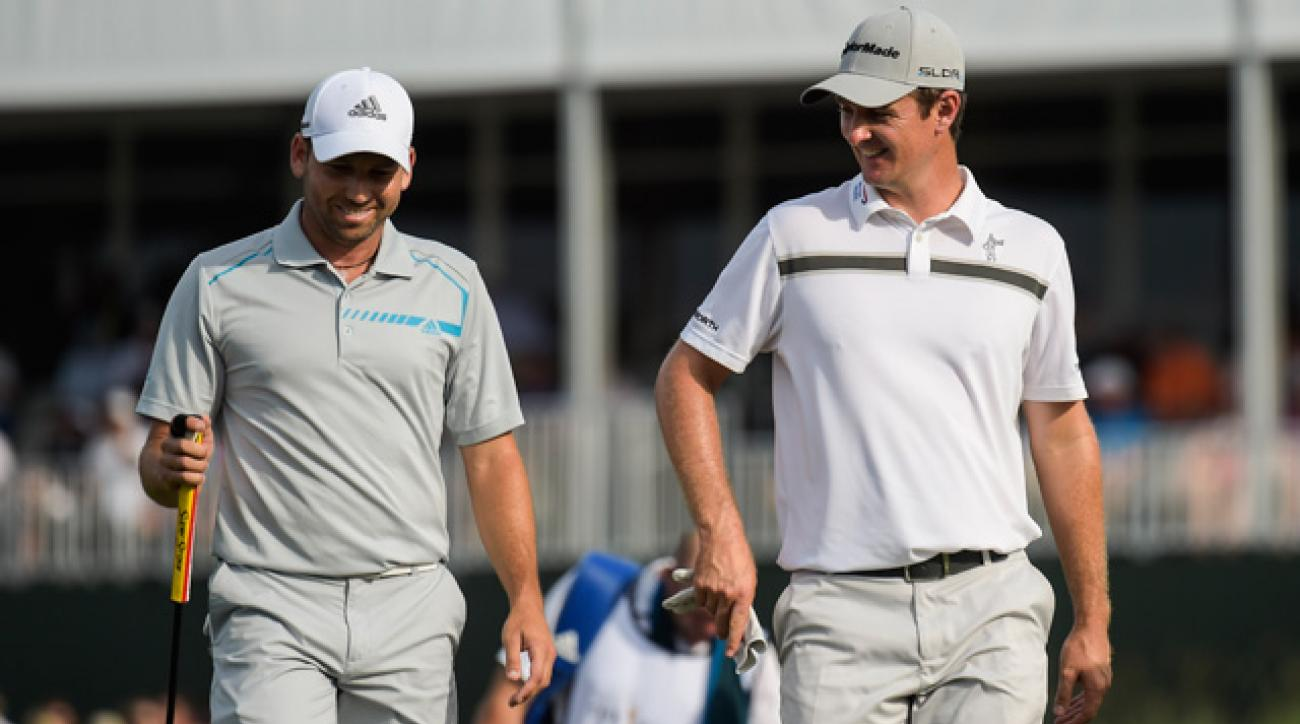 Justin Rose, right, and his playing partner Sergio Garcia walk off the 17th green at TPC Sawgrass.