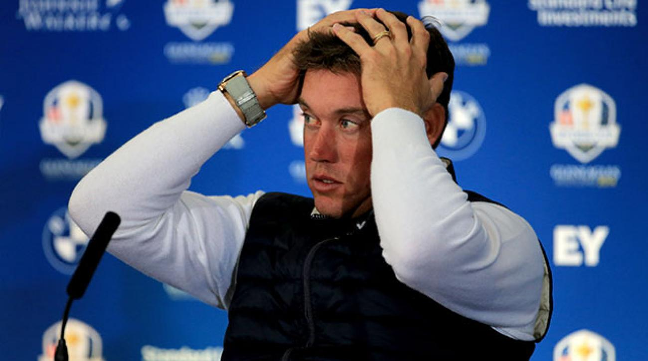 Lee Westwood reacts during a press conference following the Saturday afternoon foursomes at the 2014 Ryder Cup.