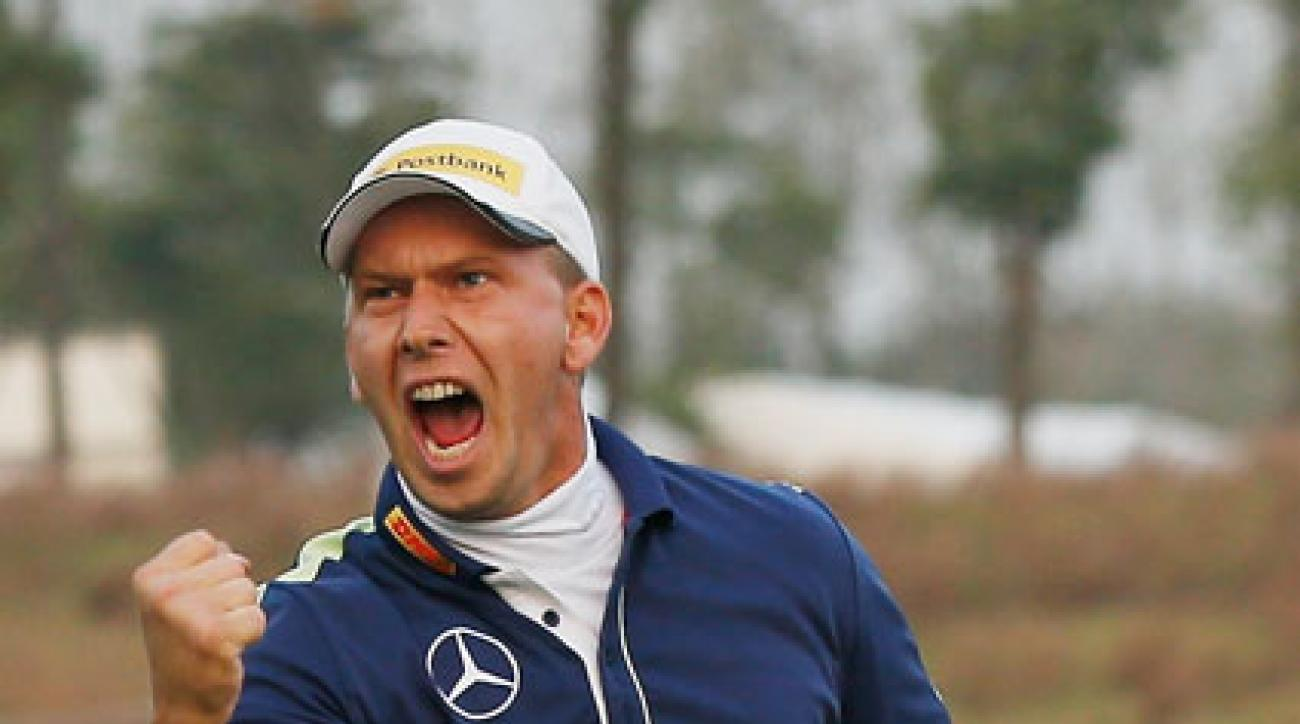 Marcel Siem celebrates after chipping in for birdie on the first playoff hole at the BMW Masters.