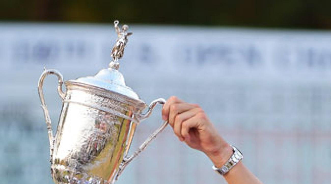 Martin Kaymer hoists the U.S. Open Championship Trophy.