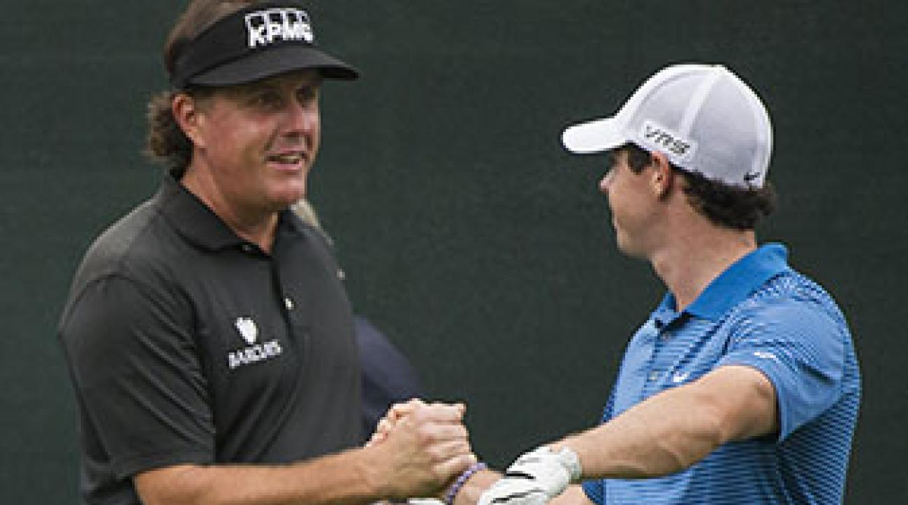 Rory McIlroy and Phil Mickelson shake hands during the Pro-Am round of The Barclays Fed Ex Championship at Ridgewood Country Club in Paramus, NJ.