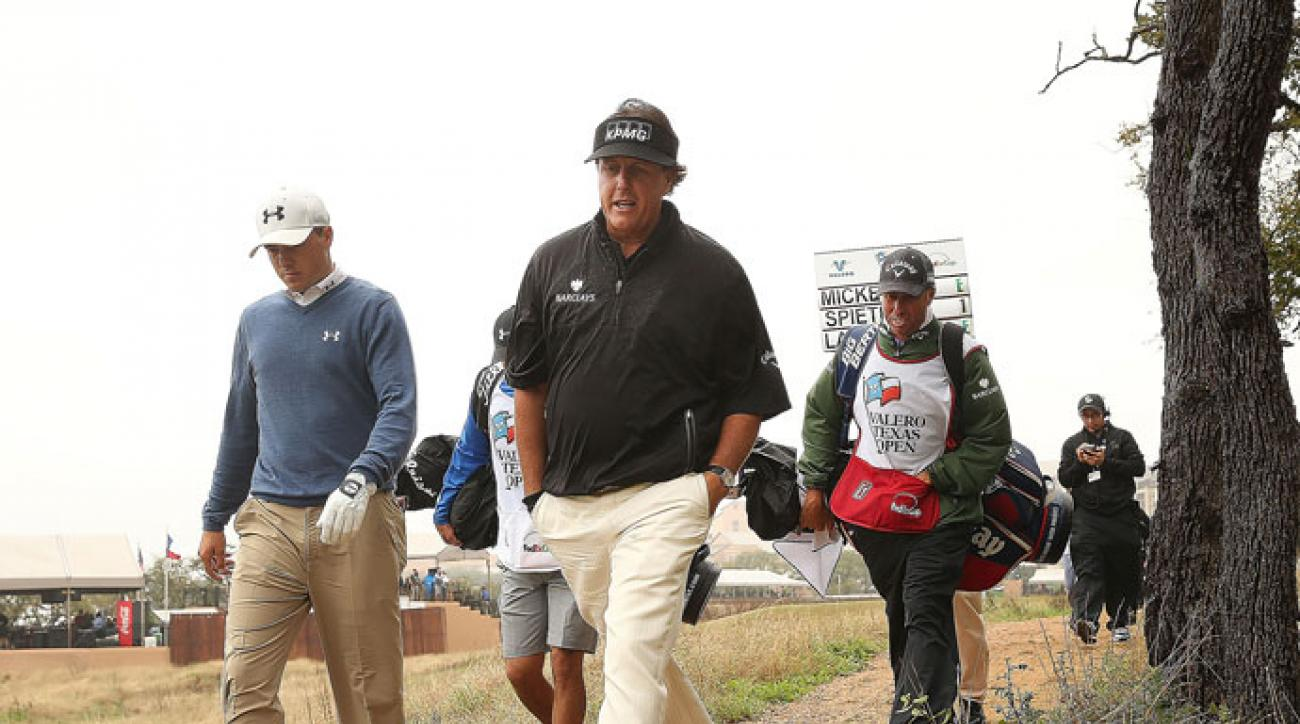 Phil Mickelson and Jordan Spieth walk from the 11th tee during the first round of the Valero Texas Open in San Antonio, Texas.