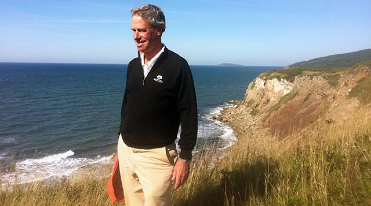 Mike Keiser surveys the land for Cabot Links in 2013.
