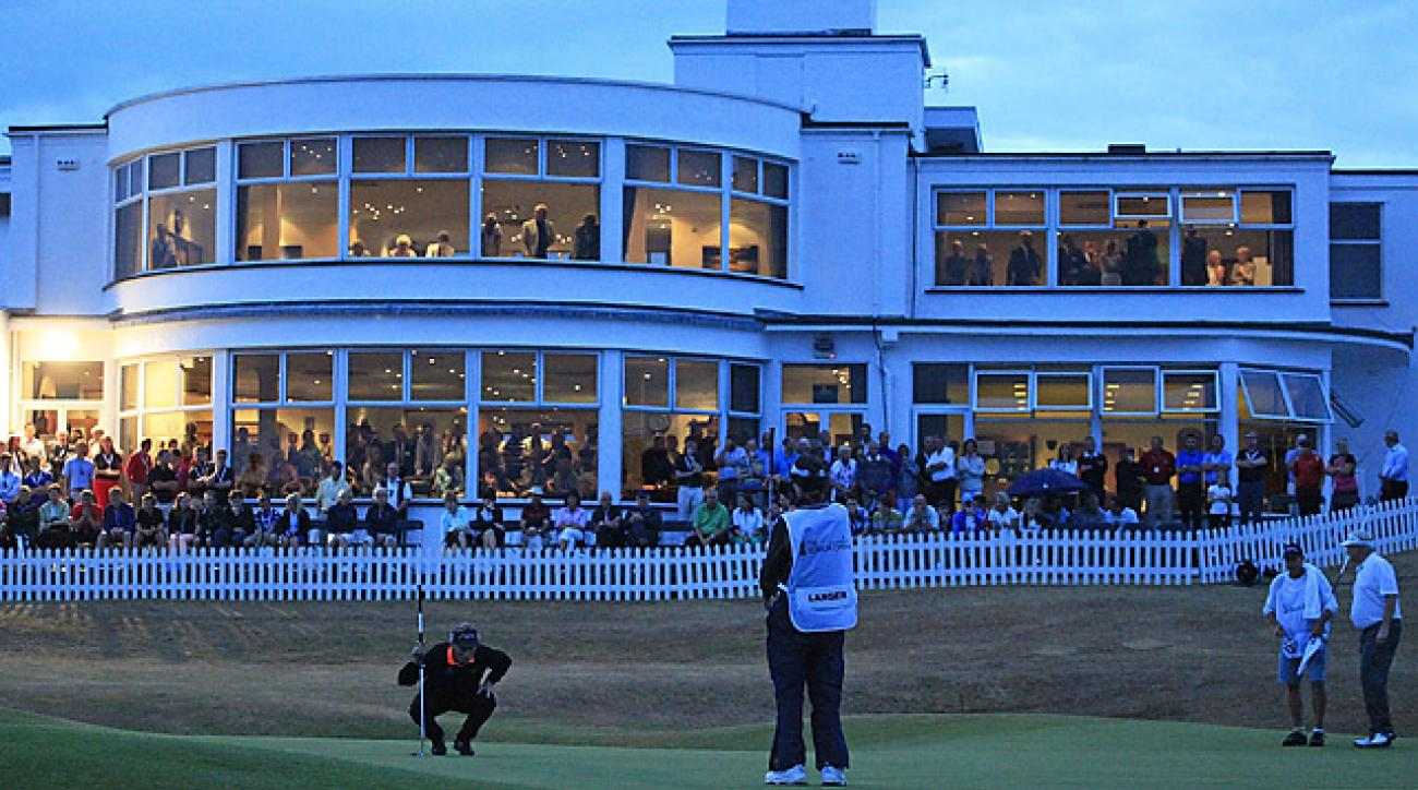 Bernhard Langer (crouching) and Mark Wiebe (far right) will finish their playoff Monday after darkness stopped play Sunday evening.