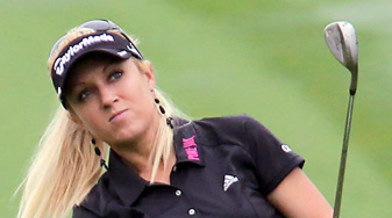 Natalie Gulbis recently appeared in the Sports Illustrated Swimsuit Issue, and in a golf instruction video with supermodel Julie Henderson.