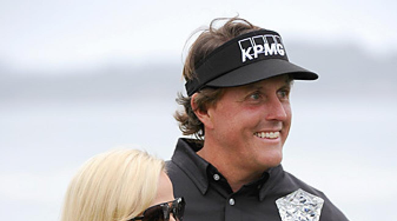 Phil Mickelson celebrated his 40th PGA Tour victory with his wife, Amy.