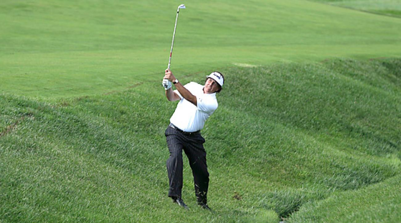 Among Mickelson's Friday follies was this right-handed attempt from a bunker.