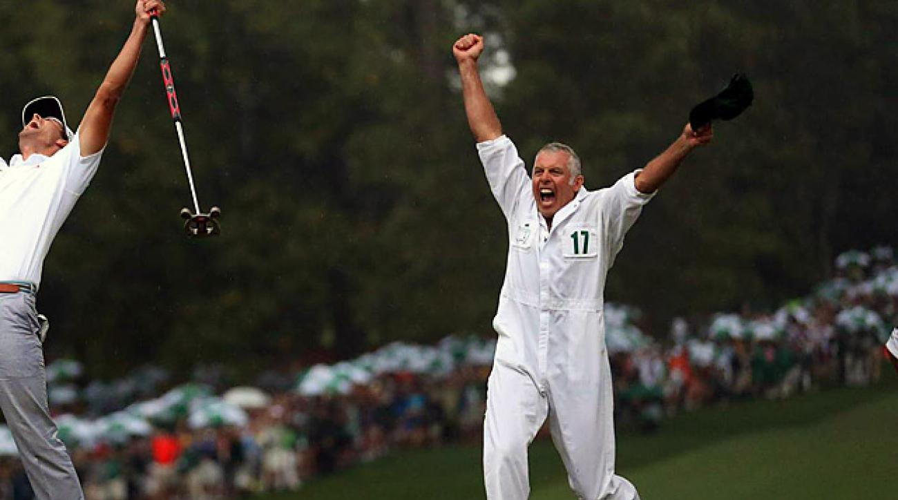 Caddie Steve Williams celebrates his fourth Masters victory.