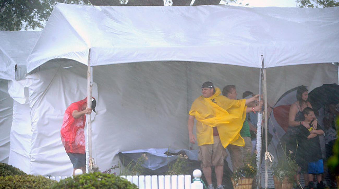 Spectators took cover under tent behind the first tee as a severe thunderstorm hit Bay Hill on Sunday afternoon.